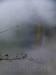 Nebel im Tal, ein Zug fährt vorbei.
